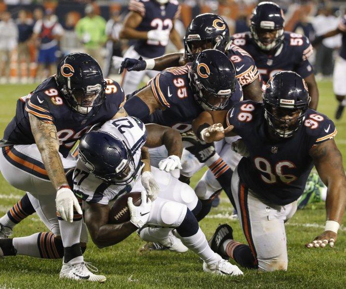 Wilson, Seahawks fumble away winnable game vs. Bears