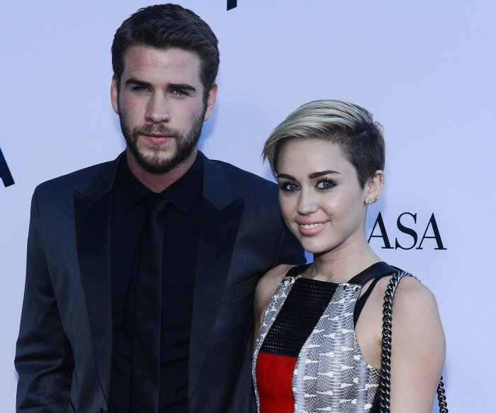 Liam Hemsworth joins Miley Cyrus after her Billboard Music Awards performance