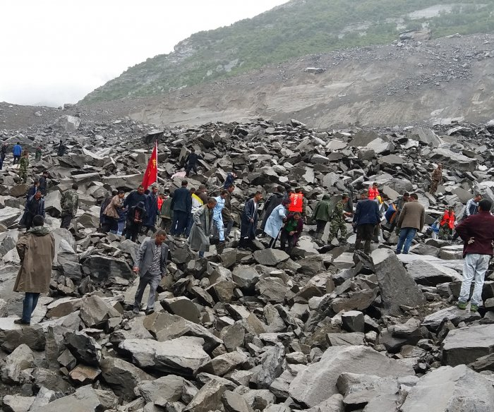 More than 120 people buried in southwest China landslide