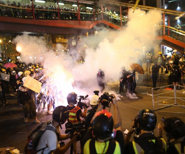 Hong Kong: 36 injured as weapon-wielding mob attacks pro-democracy protesters, journalists