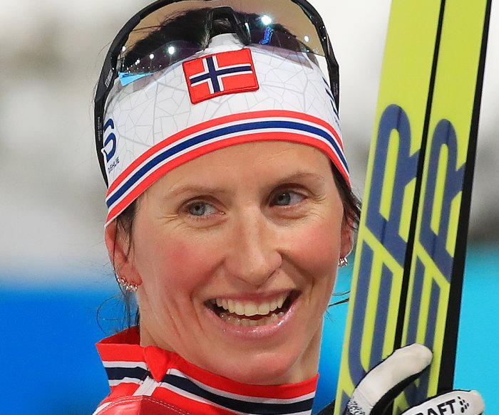 Bjoergen now most decorated Winter Olympian, U.S. makes history in skiing