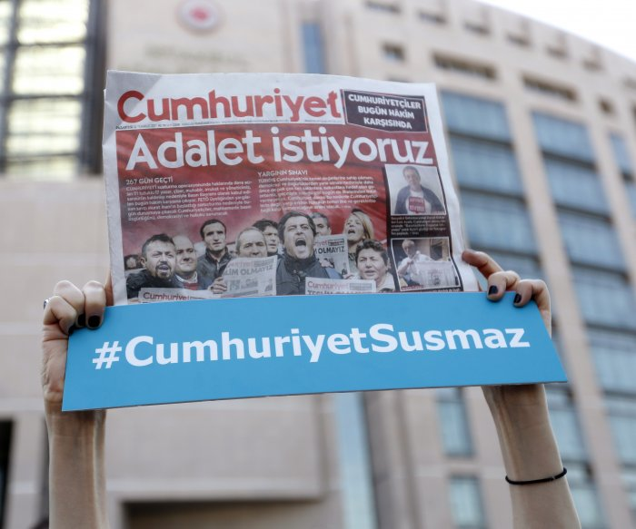 Turkish court sentences 14 journalists on terror charges