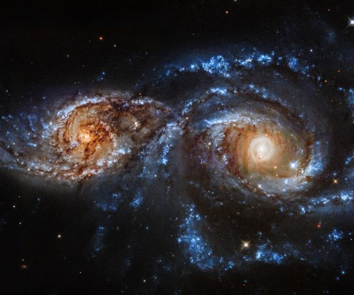 Colorful spiral galaxies collide in new Hubble video