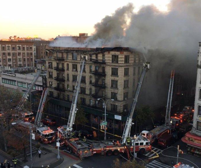 Five-alarm fire engulfs Manhattan apartment building