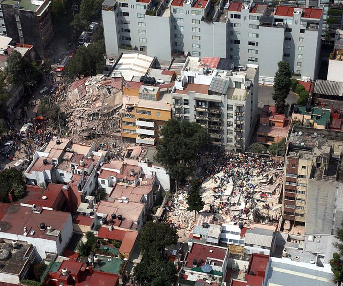 Mexico quake: Death toll falls, but likely to rise again