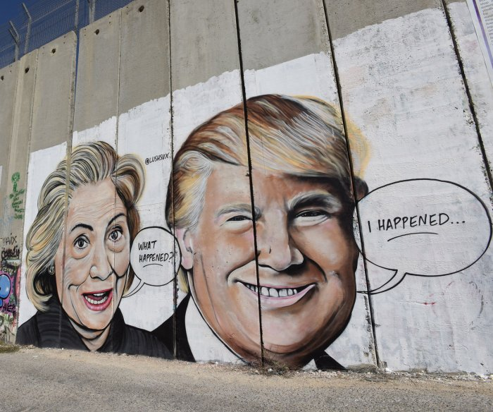 Political graffiti appears on separation wall in Bethlehem