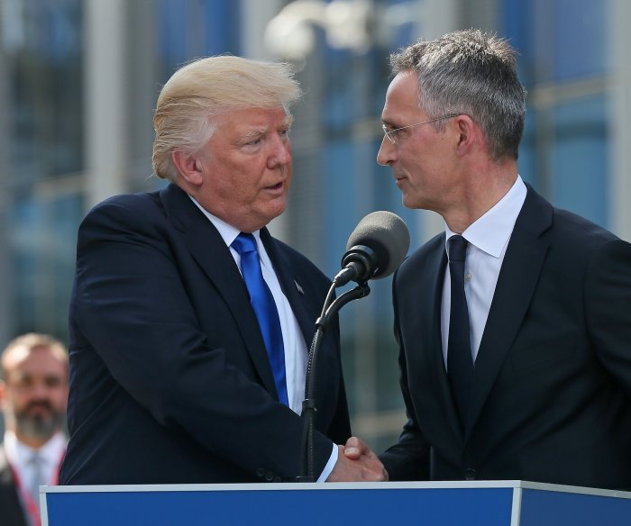 Trump urges NATO members to pay their share for defense