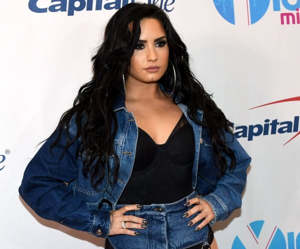 Demi Lovato, Nick Jonas walk the red carpet for Jingle Ball in Sunrise, Fla.