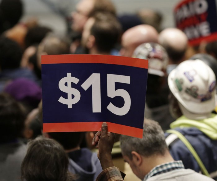 House votes to raise federal hourly minimum wage to $15