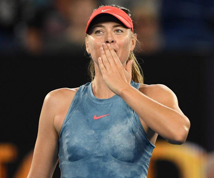 Australian Open: Sharapova upsets Wozniacki, Nadal wins