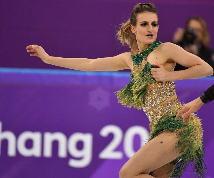 Wardrobe malfunction, world record mark Olympic ice dance