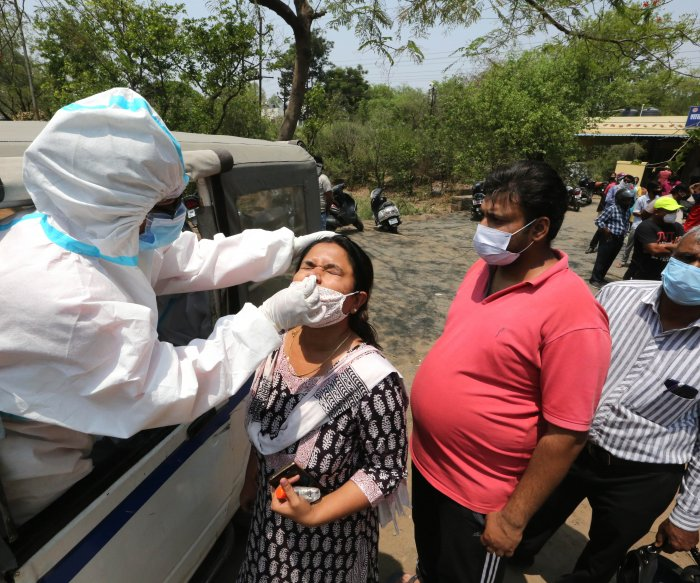 India hits record 145,385 COVID-19 cases, deaths most in 5 months