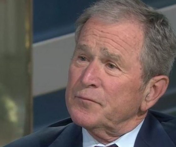 Bush defends news media, says 'we all need answers' about Russia