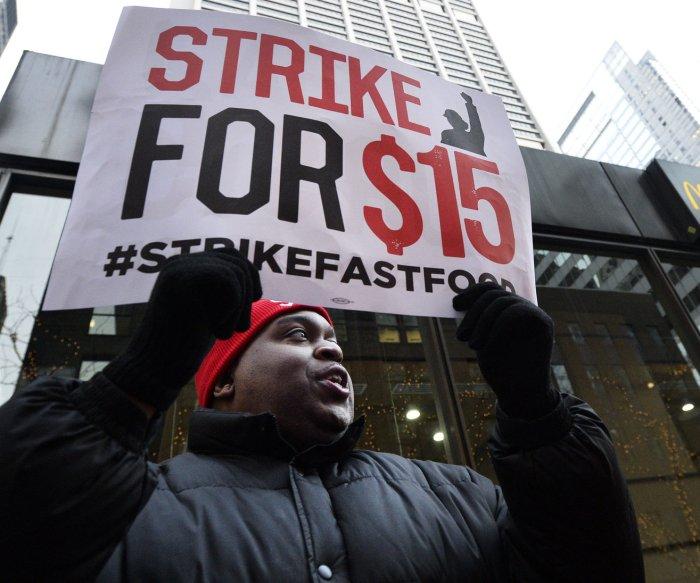 U.S. businesses take minimum wage hikes, sick leave to court