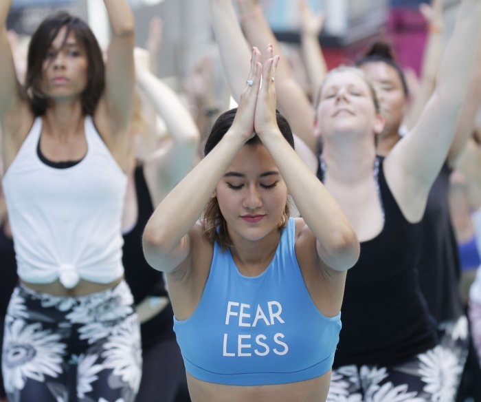 Yogis celebrate summer with 15th annual Solstice in Times Square