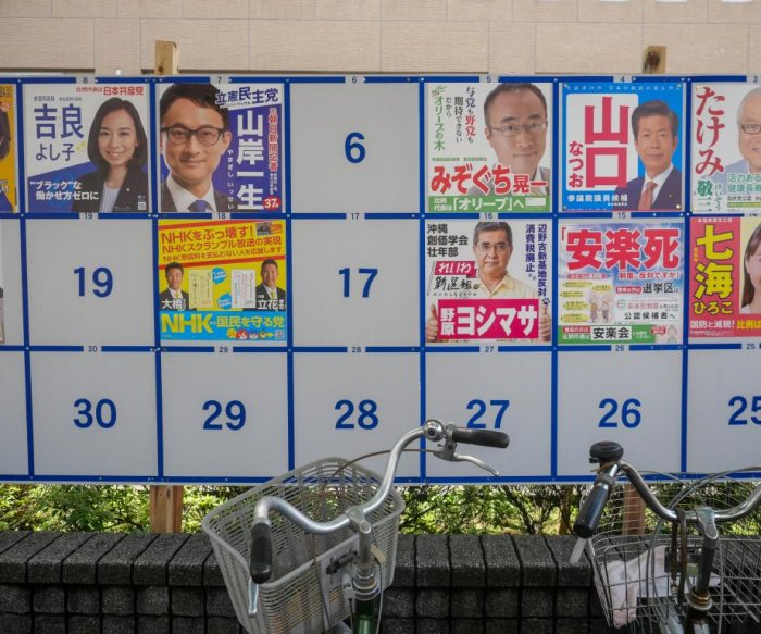 Japanese PM Abe's ruling coalition keeps majority in low turnout