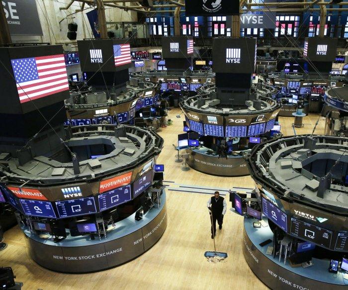 Dow Jones falls 973 points amid reports of job losses