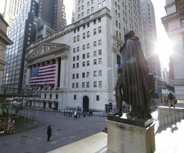 U.S. stocks end on slight downturn after early surge Tuesday