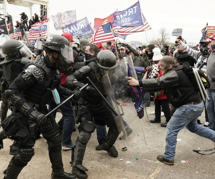 Biden unveils plan to step up fight against domestic terrorism