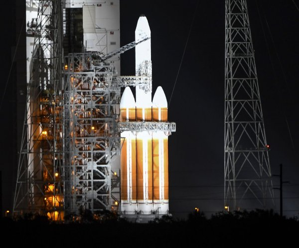 Launch of spy satellite from Florida postponed again