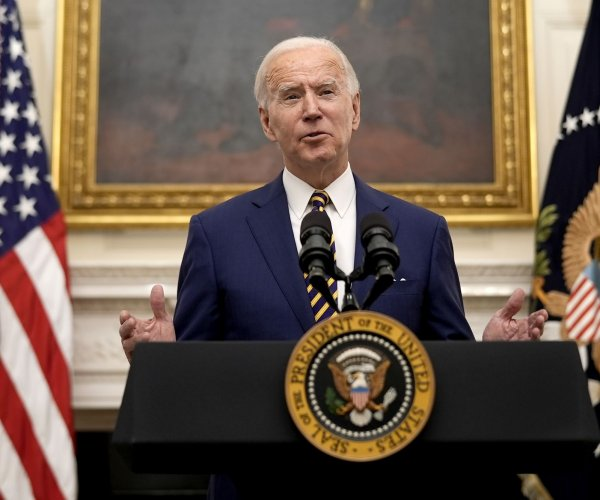 Biden signs orders for $15 minimum wage, aid for low-income families