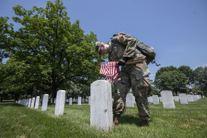 Soldiers place flags at Arlington for Memorial Day