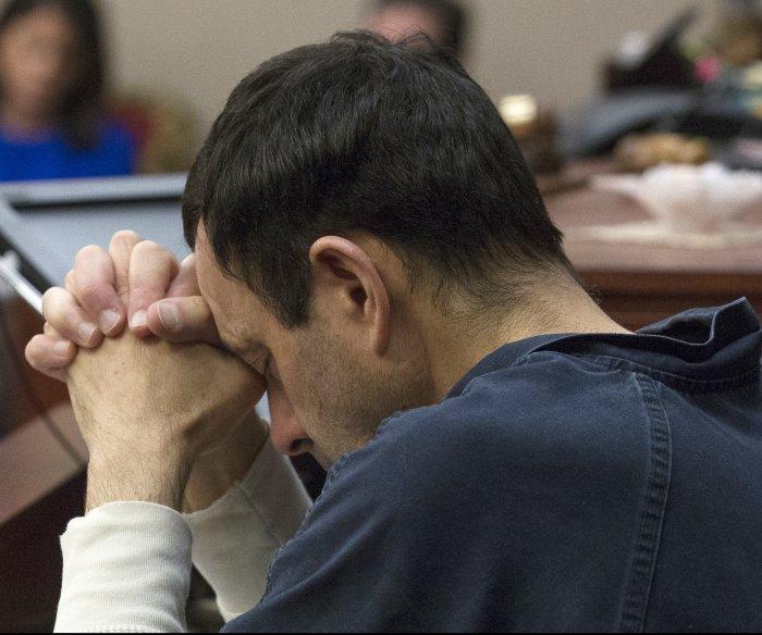 Former USA Gymnastics president arrested in Nassar case
