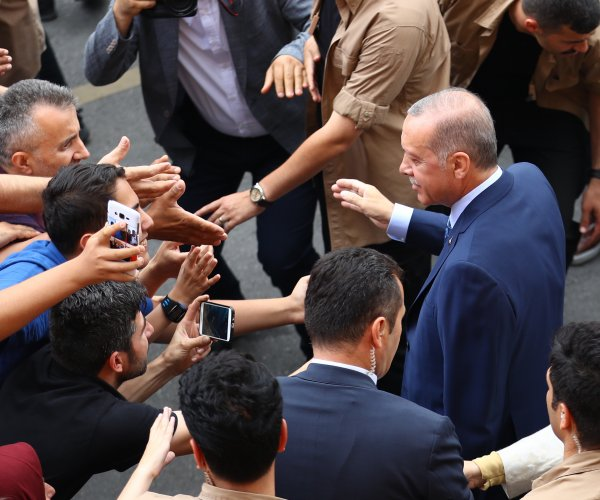 Turkish residents go to polls for parliamentary, presidential elections