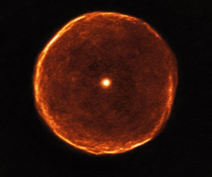 Aging red star pictured blowing smoky bubble