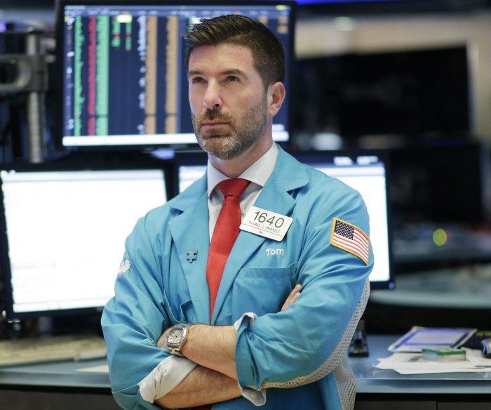 Dow sinks 879 points amid growing coronavirus fears