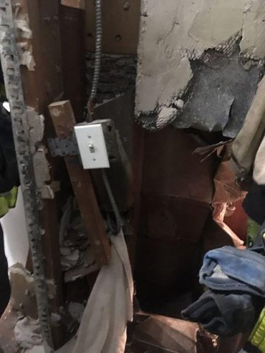 Underwear-clad-man-rescued-from-inside-wall-of-New-York-apartment