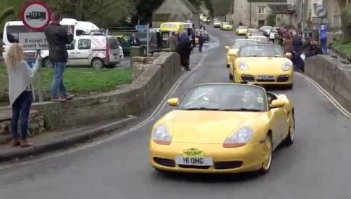 Watch: 100 yellow cars rally in support of 'ugly' car vandalized in England