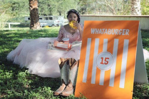 Teen-holds-Whataburger-themed-quinceanera-photo-shoot