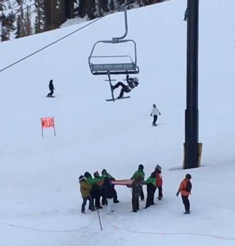 Skier-dangling-from-chair-lift-falls-safely-into-waiting-net