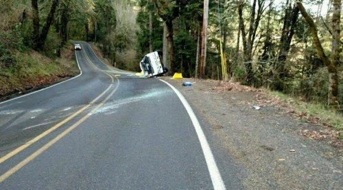 Rolled-truck-covers-rural-Oregon-road-in-fertilizer