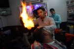 Palestinian barber uses flames to straighten hair