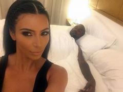 Kim Kardashian posts bedroom selfie with passed-out Kanye West