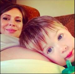 Alyssa Milano shares photo of son Milo snuggling up to her baby bump