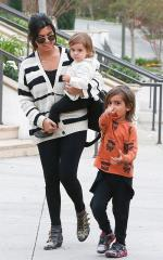 Kourtney Kardashian touts attachment parenting method in Redbook