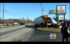 Tractor-trailer crash kills 2, injures 9