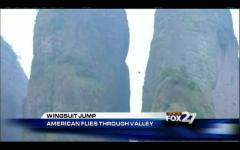 U.S. daredevil makes wingsuit flight through China mountain fissure