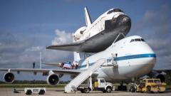 Space shuttle placed atop jumbo jet