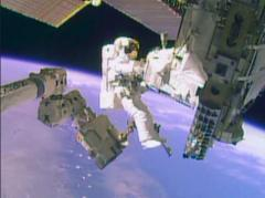 Space station astronauts finish spacewalk to replace cooling pump