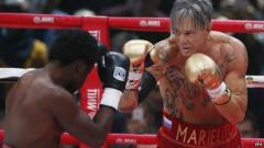 Mickey Rourke, 62, trounces young fighter