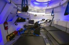 NASA astronauts get feel of new Boeing space capsule