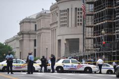 Museum shooter charged with guard's death