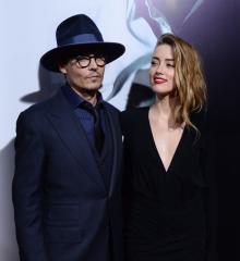Amber Heard takes Johnny Depp to '3 Days to Kill' premiere