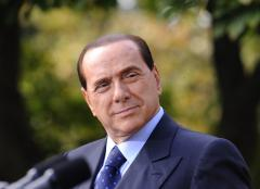Berlusconi says he would support center-left candidate to end deadlock