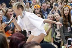 Miley Cyrus appears to smoke marijuana on stage at EMAs