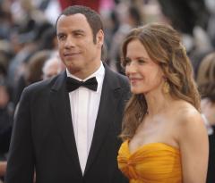 Travolta, Preston bring Jett's ashes home